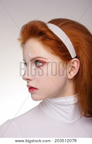 Closeup of young female with marks on skin for cosmetic medical procedures. Beauty Portrait Fashion Concept.