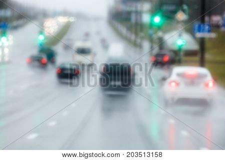 Vehicles Moving In The Wet Slippery Road During The Rain. Blurred Motion.