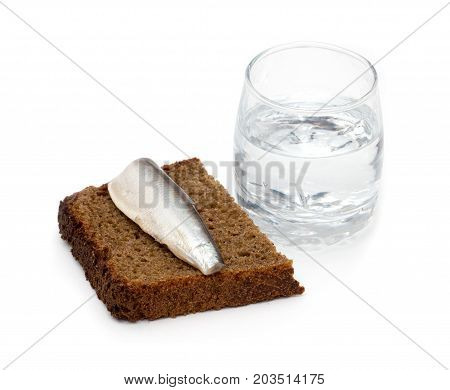 a shot of vodka with a fish on bread