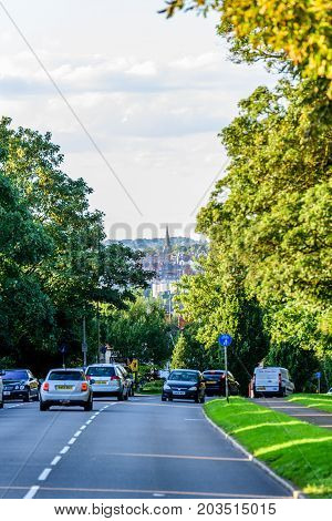 Northampton UK - Aug 15 2017: Cloudy Day Cityscape View of Northampton UK with road in foreground.