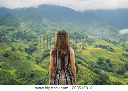 Young traveler standing and looking at view of nature in Sapa Vietnam in rainy season