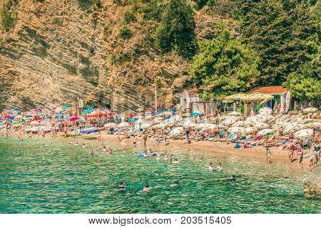 Budva, Montenegro - August 18, 2017: View of Mogren beach in Budva, Montenegro. Mogren is one of the most popular beaches on the Budva Riviera
