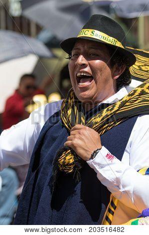 June 17 2017 Pujili Ecuador: man chanting at the Corpus Christi annual parade