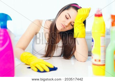 Young Woman Wiping The Dust On The Table. A House Cleaner Cleans Up Dust. Girl Smiling And Doing Hou