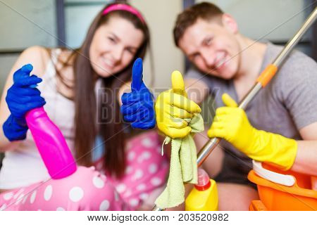 Young Husband And Wife Are Cleaning The House Together. Focus On The Hands