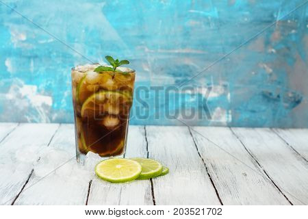 Summer cuba libre cocktail with lime and mint. Space for text