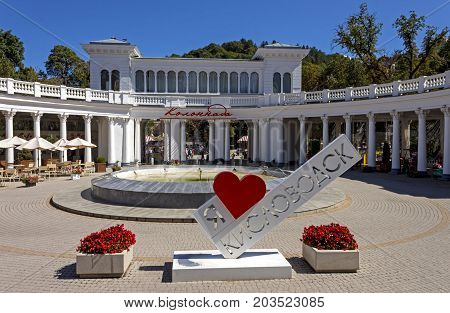 KISLOVODSK, RUSSIA - SEPTEMBER 09, 2017:The colonnade at the main entrance to the resort park is considered one of the main attractions of Kislovodsk.In the foreground there is an inscription: