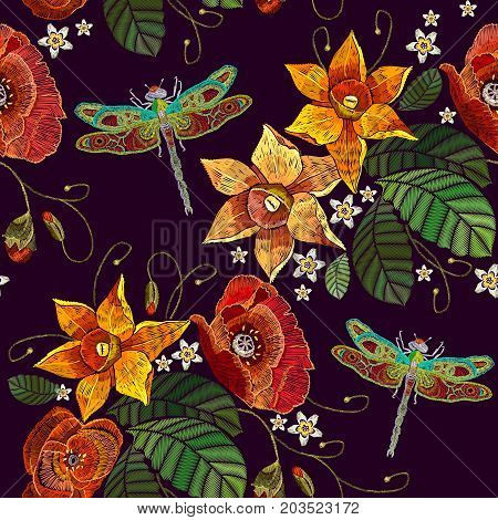 Embroidery narcissus flowers poppies and dragonfly seamless pattern. Classical embroidery on black background fashionable template for design of clothes