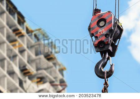 building construction site - crane hook against blue sky