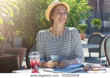 Closeup Picture Of Pretty European Girl In Beige Hat With Black Ribbon Smiling Widely While Looking
