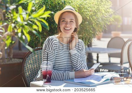 Outdoor Closeup Of Positive Beautiful Caucasian Woman In Beige Hat With Black Ribbon Spending Leisur