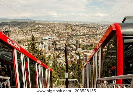 Georgia. Tbilisi. April 2017: - Funicular car in Tbilisi and view of the city from the station Pantheon. The Pantheon station is the middle station which is at the Mtatsminda Pantheon. Outdoors.