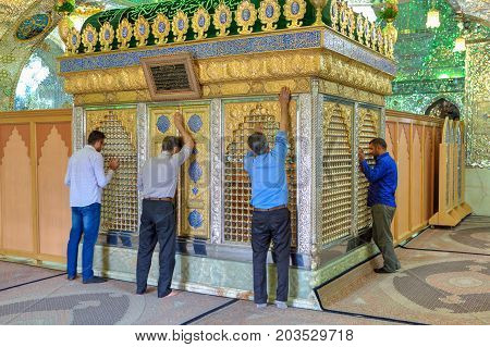 Fars Province Shiraz Iran - 18 april 2017: Muslims pray in front of Sayyed Alaeddin Hossein tomb inside Mosque.