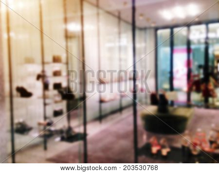 blurred image of showcases fashion shoes display in department store shopping mall shopping lifestyle concept
