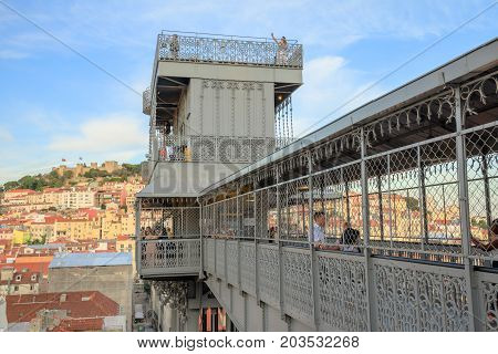 Lisbon, Portugal - August 25, 2017: iron structure of Elevador de Santa Justa also called Carmo Lift and the access deck. The popular elevator, or lift, connecting Baixa district to Igreja do Carmo.