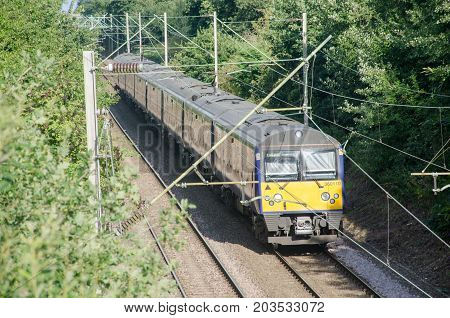 Alresford Essex United Kingdom -12 August 2017: UK train Carriage Electric four piece unit on Track in woods