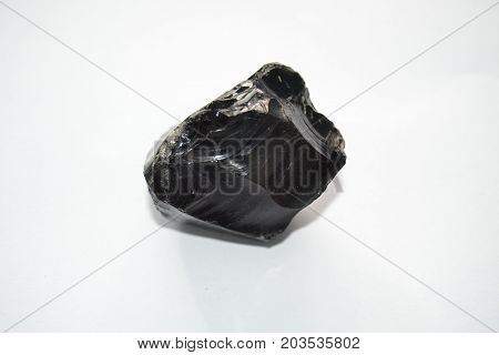 Obsidian , Raw obsidian on a white background