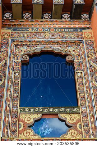 Traditional Bhutanese temple architecture in Bhutan South Asia. View of the beautiful ornated window of the temple.