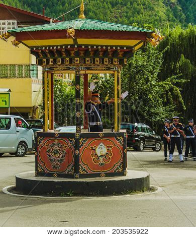Thimphu, Bhutan - September 10, 2016: Traffic Policeman With White Gloves On Duty In Thimphu City Ce