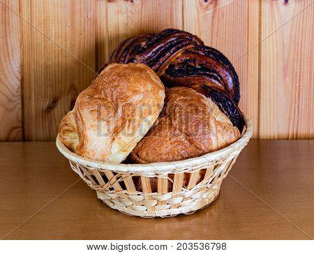 Fresh sweet pastry in basket. Selective focus