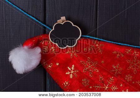 Santa Claus caps hang on a rope an inscription Christmas