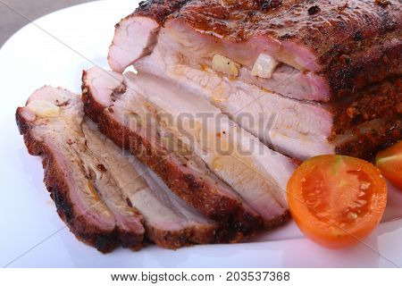 grilled pork chops with tomato and ketchup on plate