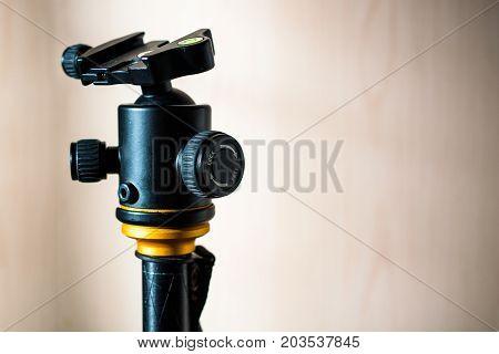 Head of black tripod camera. Adjustable platform.