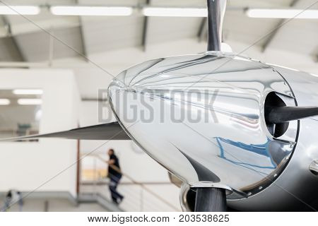 Detail of a propeller cone aircraft in a hangar.