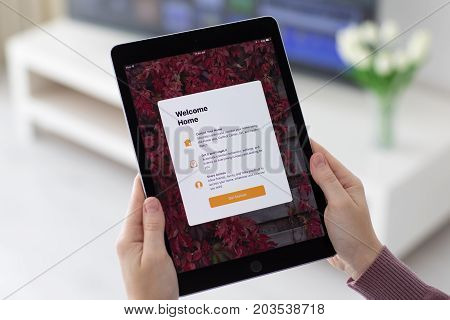 Alushta Russia - May 23 2017: Woman hand holding iPad Pro Space Gray with app Home in the screen. iPad Pro was created and developed by the Apple inc.