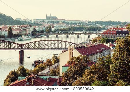 View from the Vysehrad to the castle and river Vltava with bridges Prague Czech republic. Travel destination. Retro photo filter.