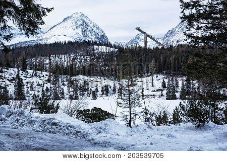 Solisko peak with springboard for ski jumping Strbske pleso Slovak republic. Winter mountains.