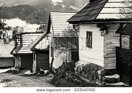 Beautiful wooden houses in Vlkolinec village Slovak republic Unesco. Cultural heritage. Travel destination. Black and white photo.