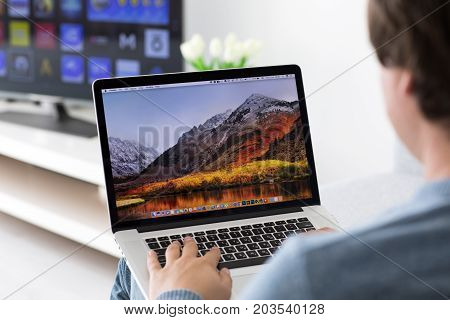 Alushta Russia - June 8 2017: Backgrounds MacOS High Sierra in the screen of MacBook Pro. MacBookPro was created and developed by the Apple inc.
