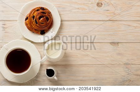 Cups with tea and biscuits on a light wooden background. Top view.