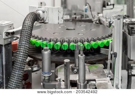 the machine prints on plastic lids. printing on plastic caps