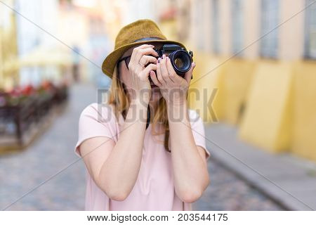Travel Concept - Young Woman Tourist With Camera