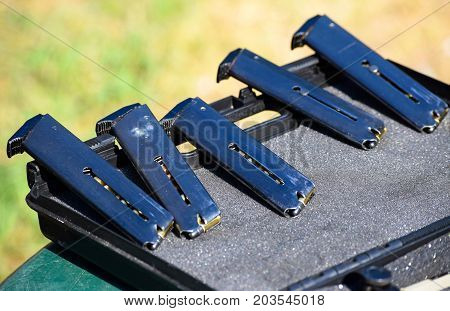 Magazines of the handgun in a row
