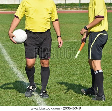 Two soccer referees before the match outdoor