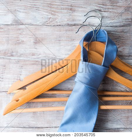 Wooden Clothes Hangers With Man's Tie