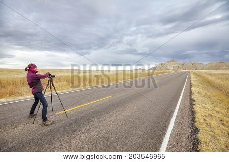 Landscape Photographer Takes Pictures On An Empty Road.
