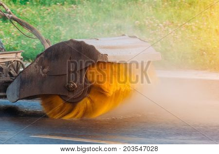 Brush On The Sweeper Rotates The Streets Cleaning Asphalt