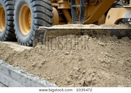 Motor Grader Pushing Earth