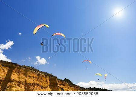 Paragliding on a Hot summer day at a South Brittany beach overlooking the Bay of Biscay