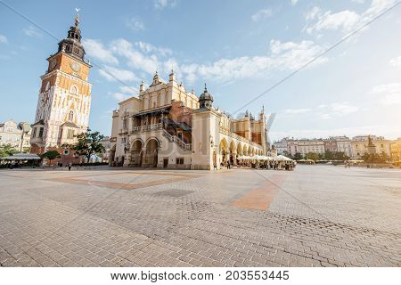 Cityscape view on the Market square with Cloth Hall building and town hall tower during the morning light in Krakow, Poland
