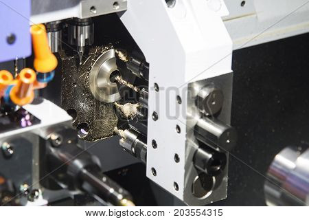 Multi function CNC lathe machine cutting the small part .Hi technology manufacturing