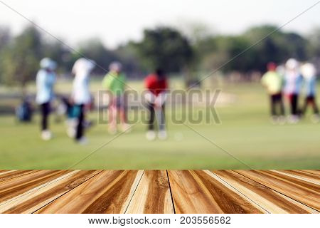 Perspective Wood And Blurred Golfers Hit Sweeping And Keep Golf Course In The Summer For Relax Time