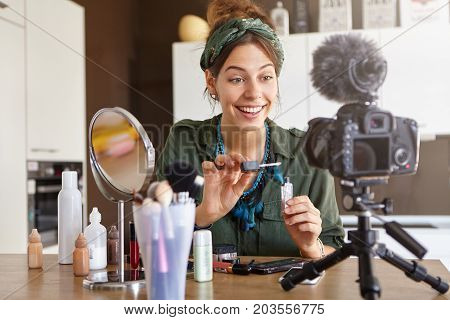 Female Video Channel Host Using Lip Gloss For Putting Make Up, Telling About Cosmetics To Her Custom