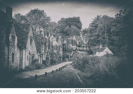 Vintage Photo Effect Medieval Arlington Row In Cotswolds Countryside Landscape In England