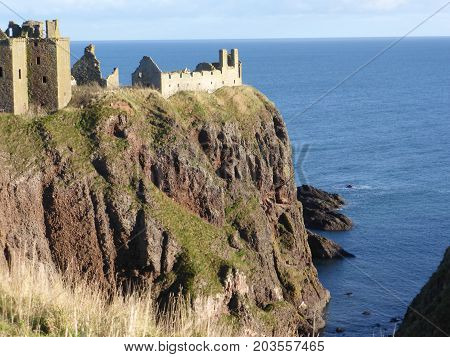Dunnottar Castle, dramatic, romantic and haunting ruined cliff top fortress near Stonehaven, Aberdeenshire, Scotland,
