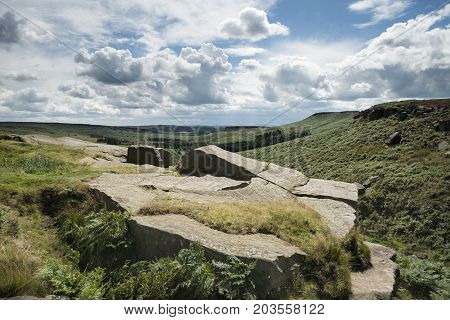 Colorful vibrant landscape image of Burbage Edge and Rocks in Summer in Peak District England poster